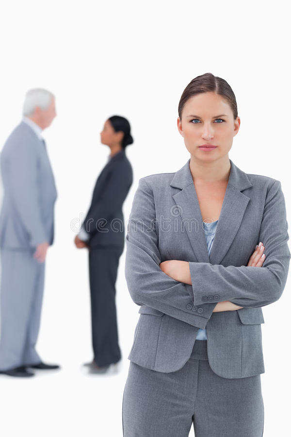 Download Serious Businesswoman With Arms Folded And Colleagues Behind Her Stock Image - Image: 22858933