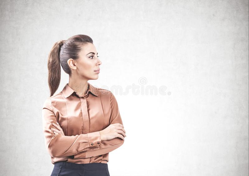 Serious businesswoman with crossed arms, mock up stock photography