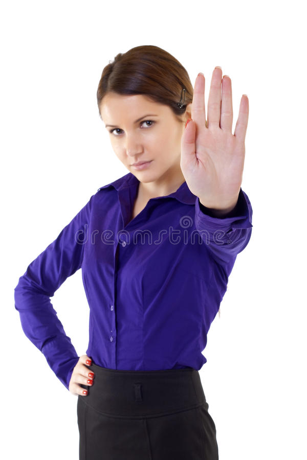 Serious businesswoman making stop sign. Over white, focus on hand royalty free stock photography