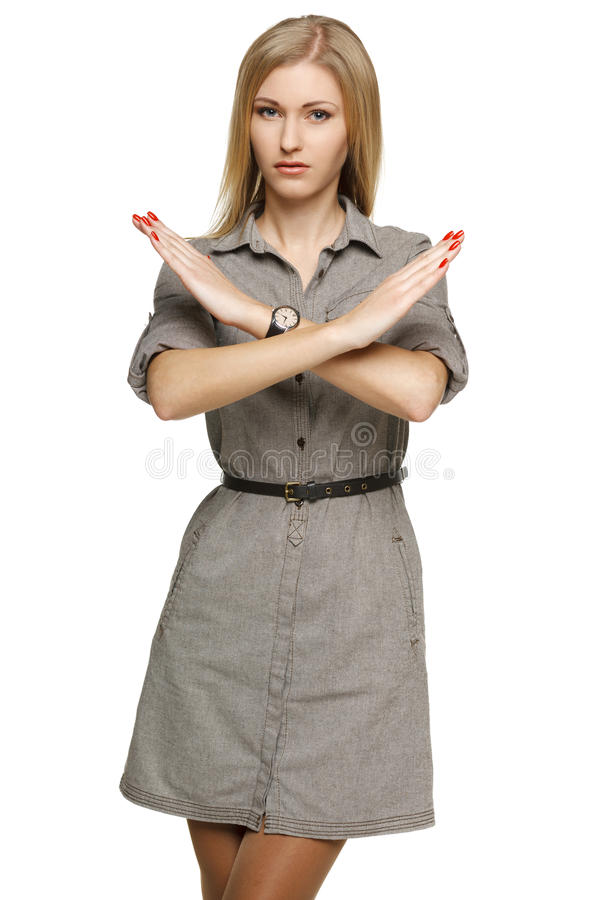 Serious businesswoman making stop sign royalty free stock photo