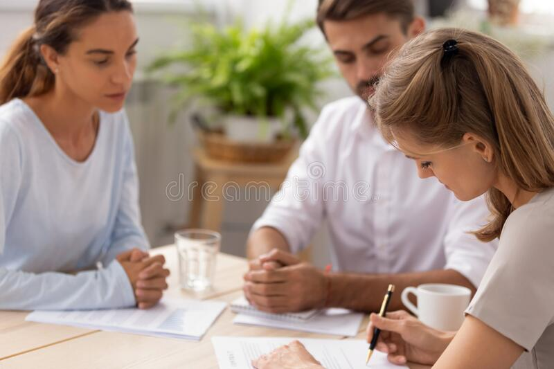 Serious businesswoman signing contract at meeting with business partner royalty free stock images
