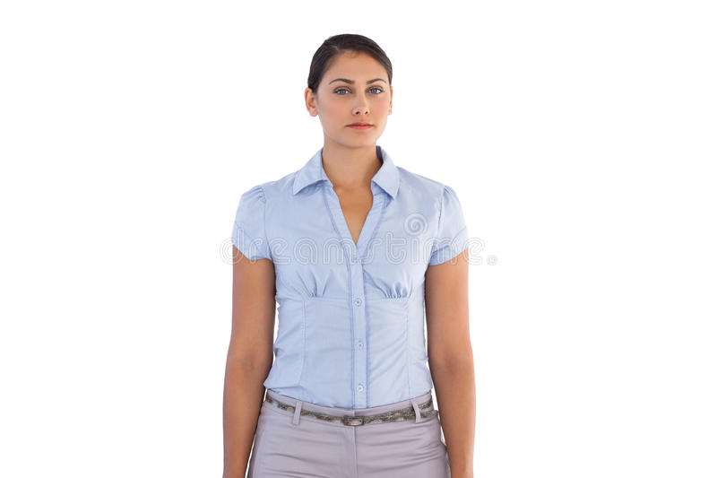 Serious businesswoman standing alone royalty free stock image