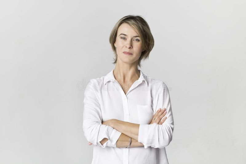 Businesswoman studio portrait. Confidence woman in white shirt isolated on white royalty free stock images