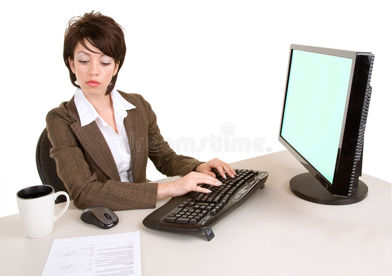 Serious Businesswoman Working at a Computer