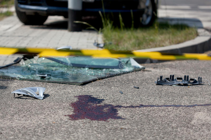 Serious car accident. Horizontal view of serious car accident with victim stock photography