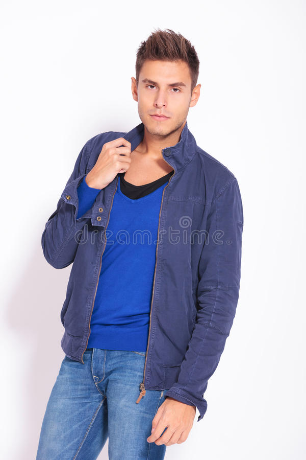 Serious casual fashion man in blue jacket stock image