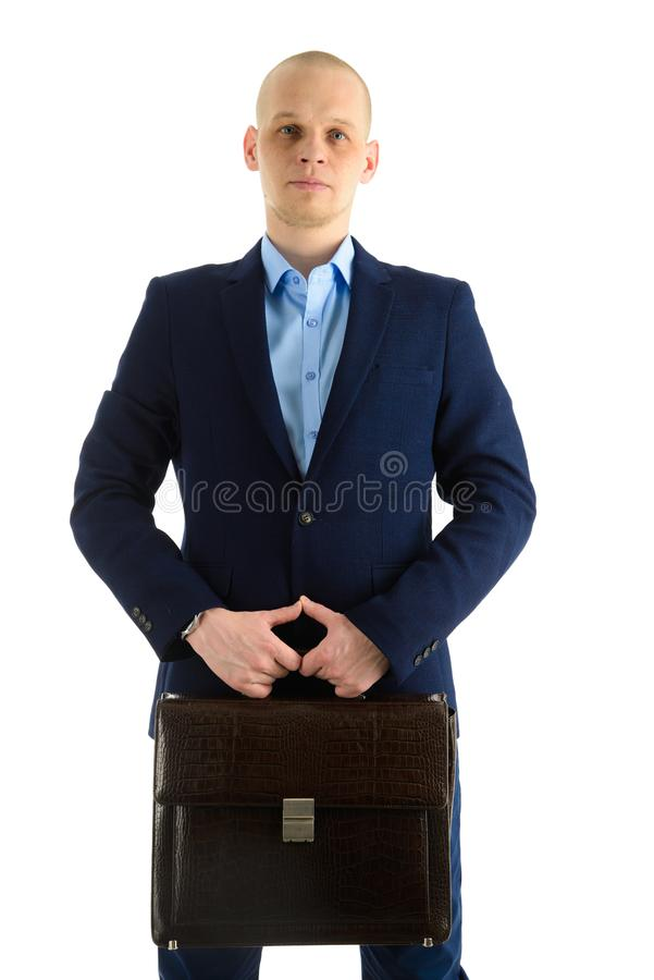 Serious Caucasian businessman in suit with case standing standing full length portrait, isolated on white background. stock photography