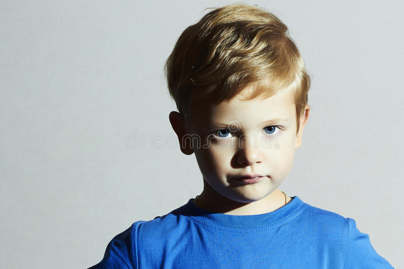 Serious Child.funny child Little Boy with Blue Eyes.Children emotion. Portrait of serious Child.funny child Little Boy with Blue Eyes.Children emotion stock photos