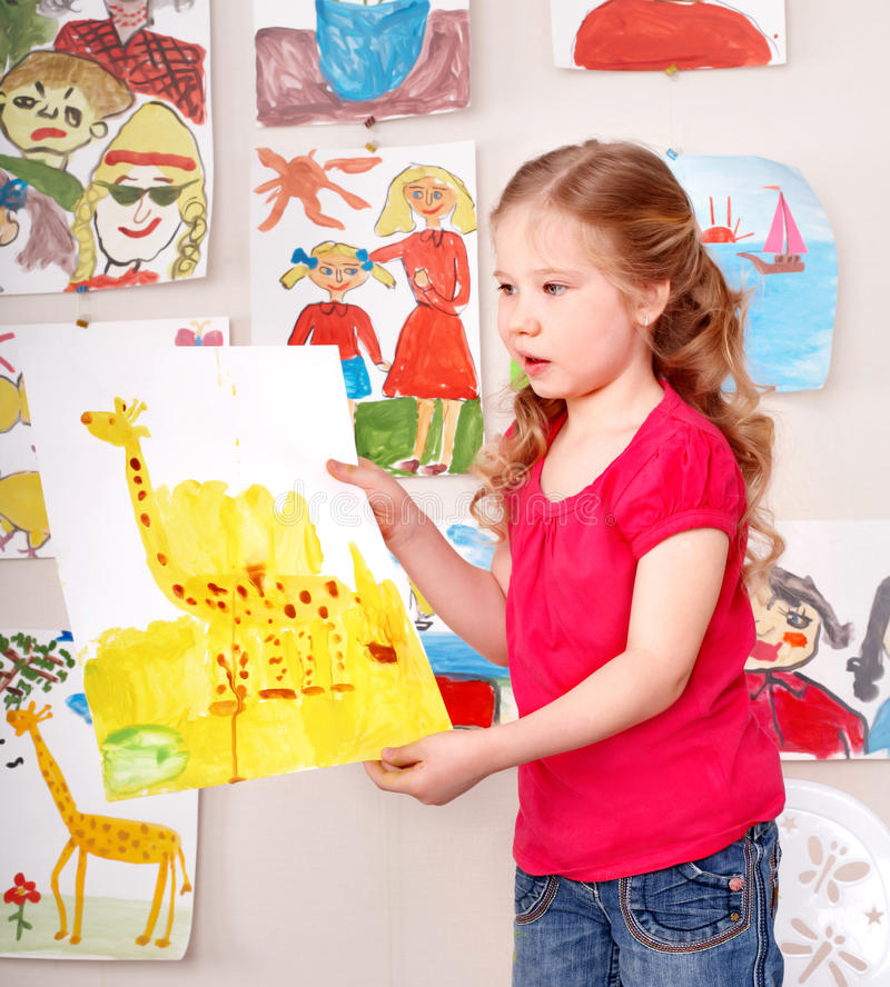 Serious child paint picture. royalty free stock photography