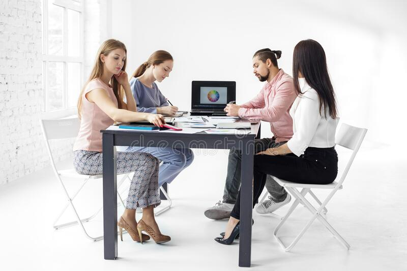 Serious colleagues work in the office. The concept of entrepreneurs, success, making money and work. Serious colleagues work in the office. Group business. The royalty free stock photos
