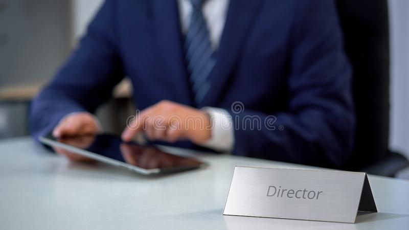 Serious company director using tablet pc on workplace, checking important files. Stock photo royalty free stock photos