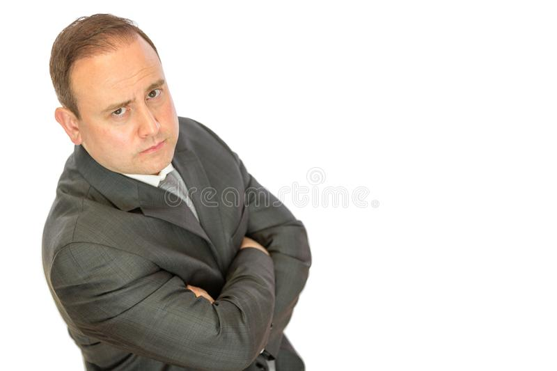 Serious, concerned manager with folded arms royalty free stock photography