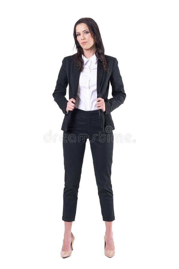 Serious confident business woman in formal style fashion posing and looking at camera stock photos