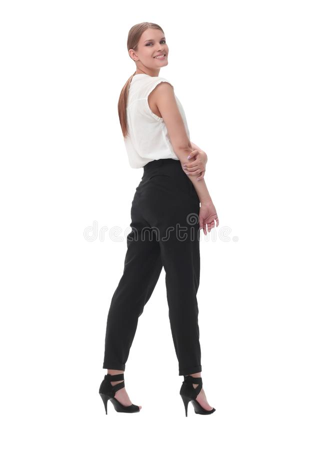 Serious confident business woman looking at camera. isolated on white. In full growth. serious confident business woman looking at camera. isolated on white stock photography