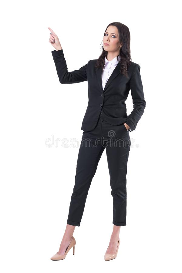 Serious confident businesswoman pointing finger up doing presentation. royalty free stock photos