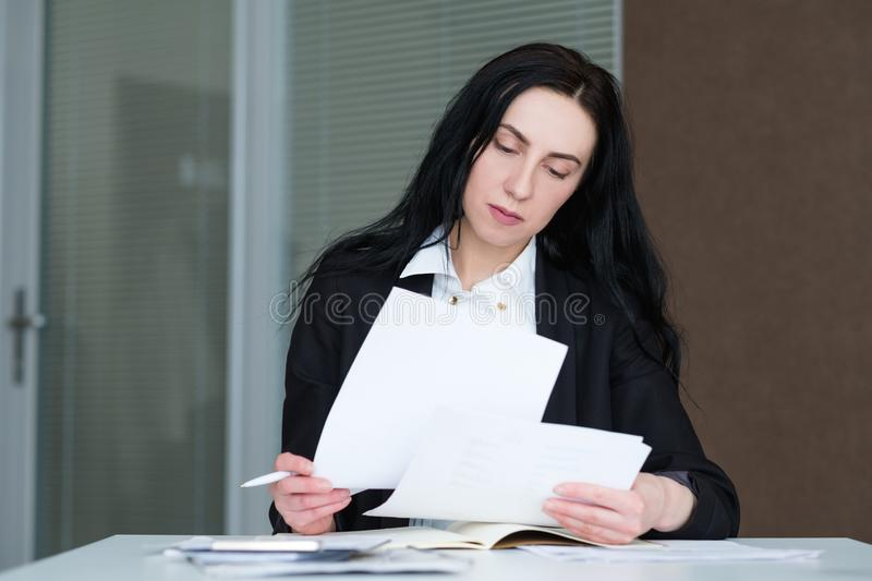 Serious confident busy business woman paperwork stock photo