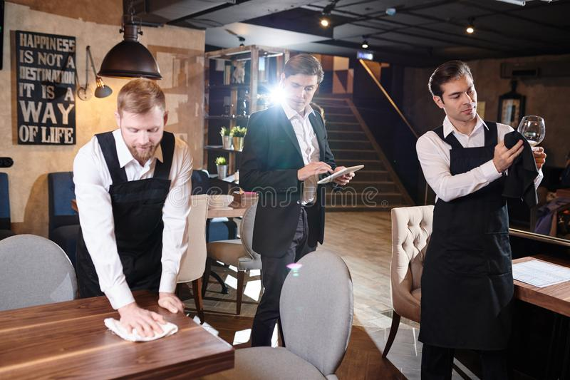 Restaurant manager controlling waiters royalty free stock image