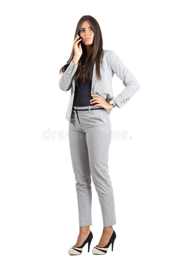 Free Serious Corporate Woman Talking On The Phone Looking Away Royalty Free Stock Photography - 60021337