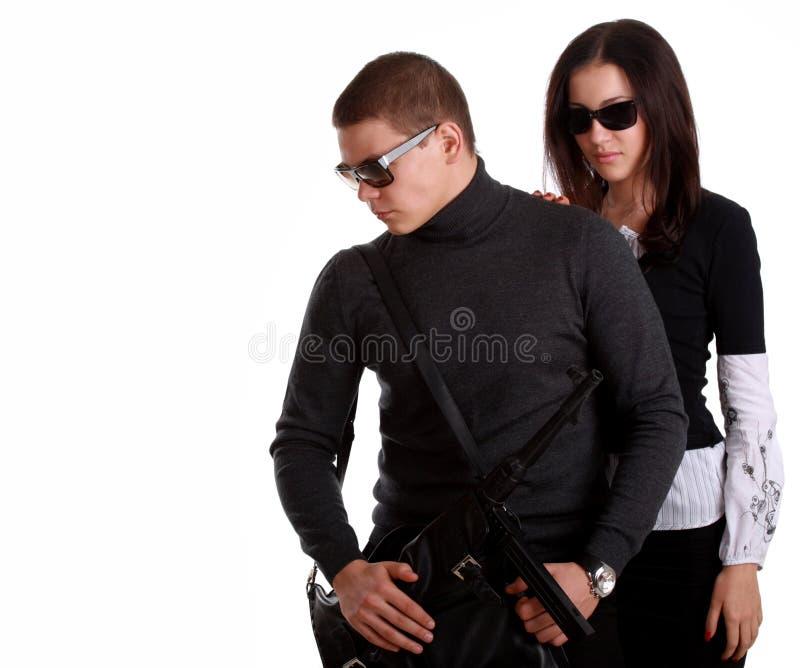 Serious couple with arms stock photos
