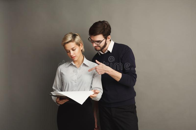 Serious couple in formal clothes on gray background royalty free stock images