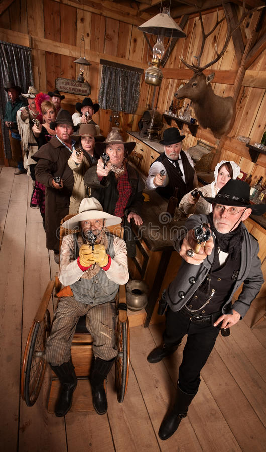 Serious Crowd With Guns In Saloon Royalty Free Stock Photos