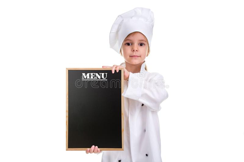Serious cute girl chef white uniform isolated on white background. Girl with a floured face holding a menu black empty royalty free stock images