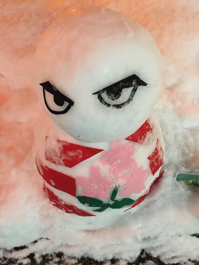 Serious and cute snowman design royalty free stock image
