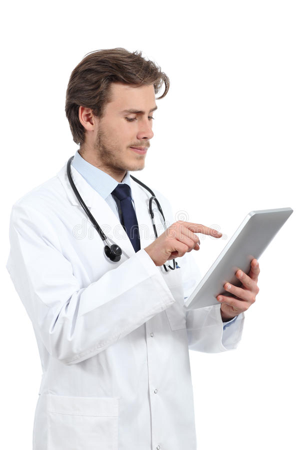 Serious doctor man browsing a tablet reader royalty free stock images