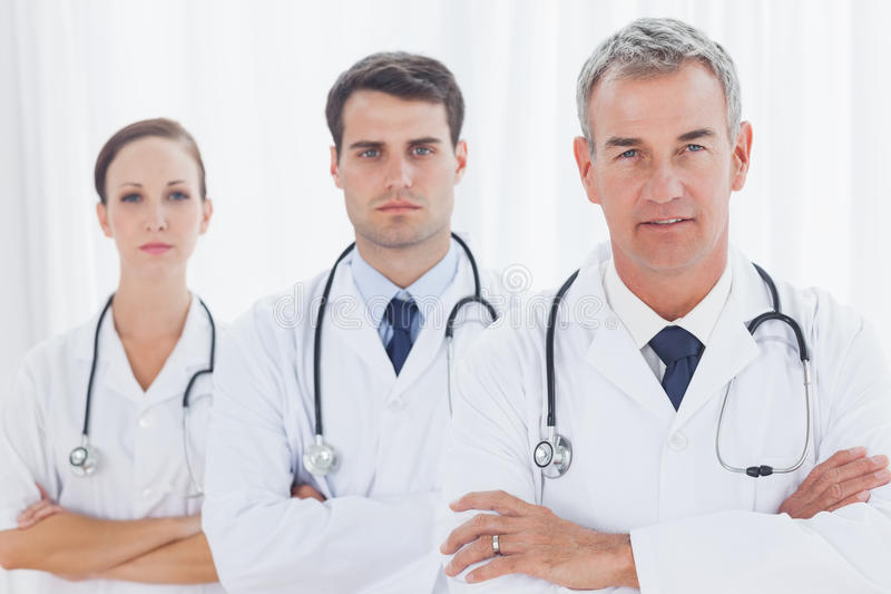 Download Serious Doctors Posing Together Stock Image - Image: 33051267