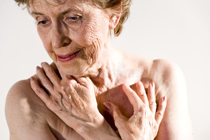 Serious elderly woman stock images