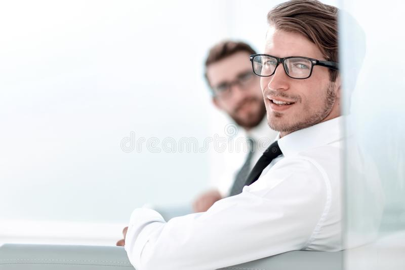 Serious employees sitting in the office waiting room stock photo