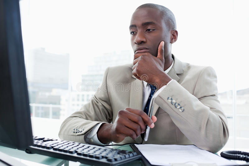 Serious entrepreneur while working with a computer royalty free stock photos