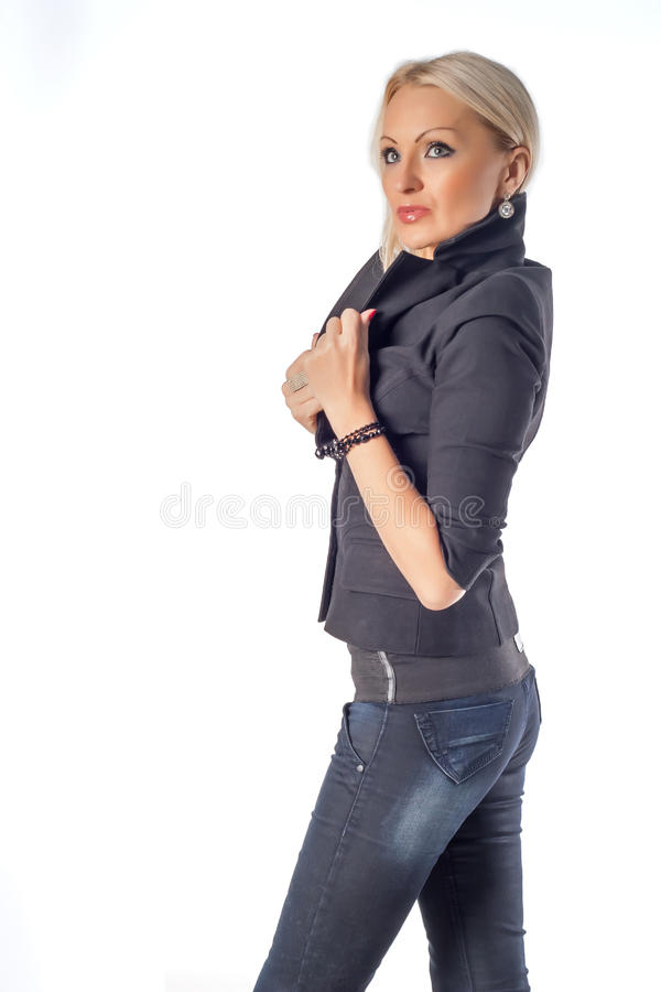Serious fashion woman. Isolated over white background royalty free stock image
