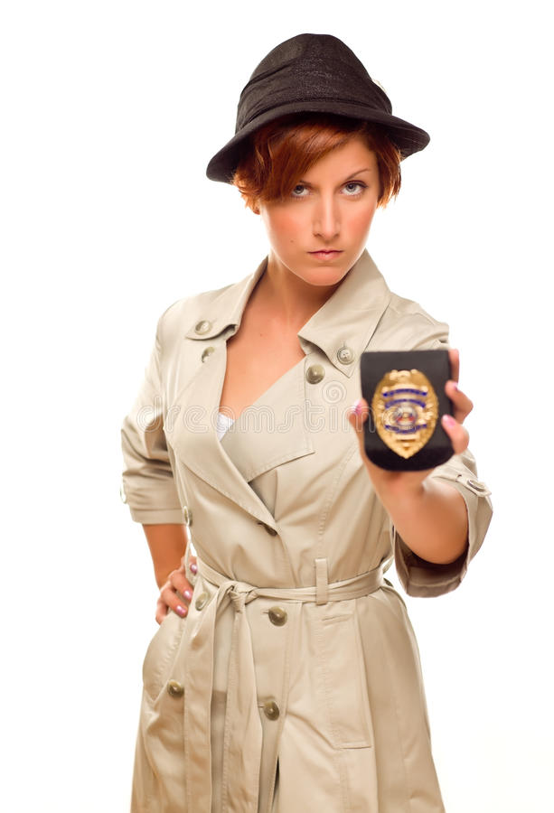 Serious Female Detective With Official Badge In Trench Coat on White royalty free stock photos