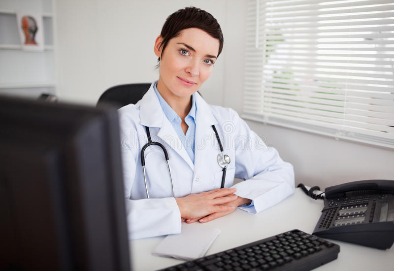 Serious female doctor looking at the camera stock photos