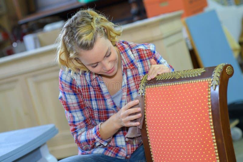 Serious female furniture designer stock photos
