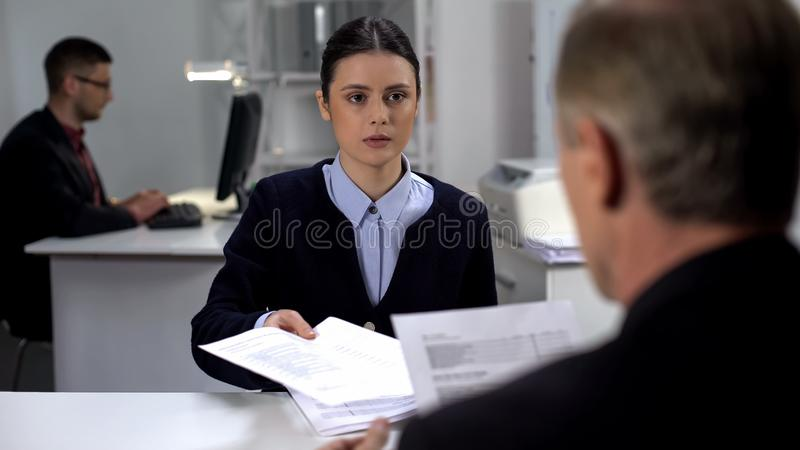 Serious female manager presenting annual report to company CEO, analytics royalty free stock photo