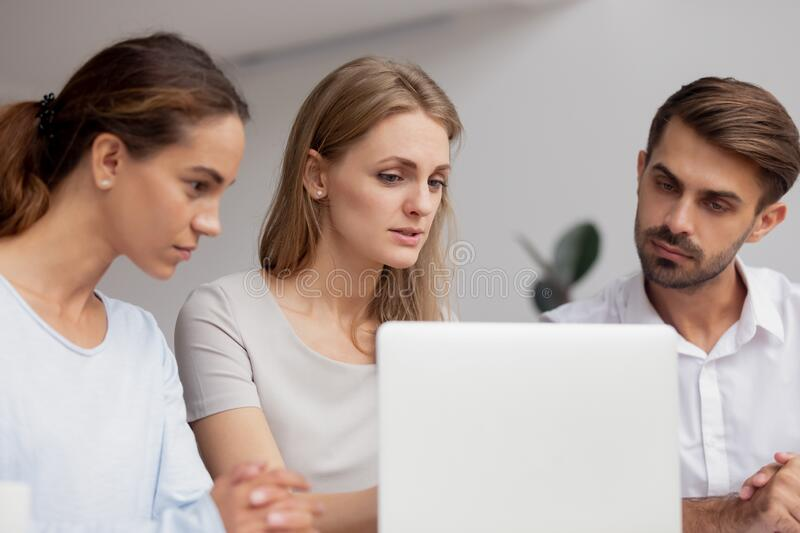 Serious businesswoman mentor training staff, explaining online project royalty free stock photo