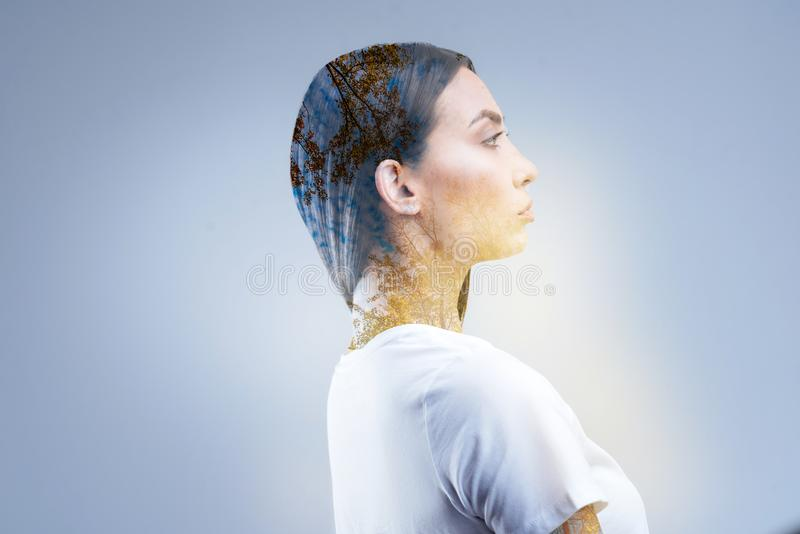 Serious focused woman moving forward. Determination in actions. Concentrated young calm woman acting in her interest while searching for bravery and standing in royalty free stock images