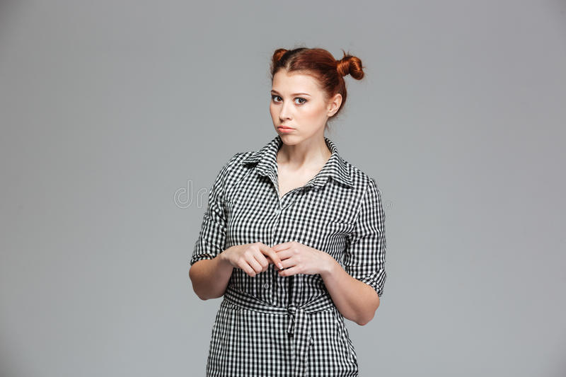 Serious funny young woman in checkered shirt royalty free stock photo