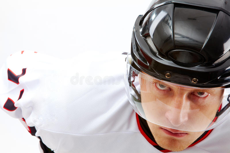 Serious game. Portrait of sportsman in hockey uniform looking at camera with severe expression royalty free stock image