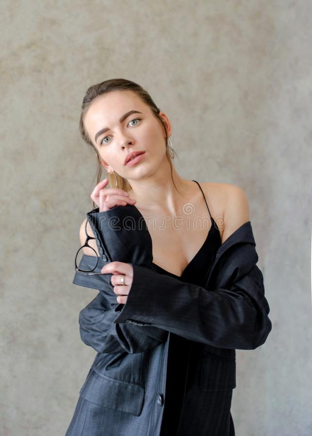 Serious girl in jacket on body, on textured background stock photography