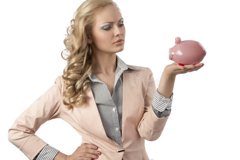 Serious girl with piggybank stock photo