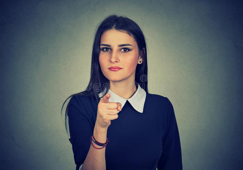 Serious girl pointing at camera in choice royalty free stock images