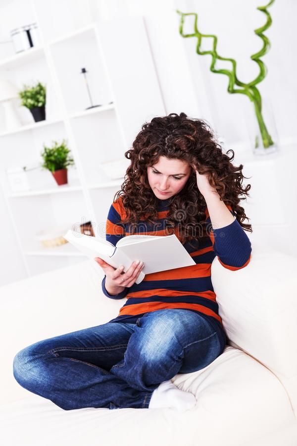 Download Serious girl reading stock photo. Image of hair, female - 27591700