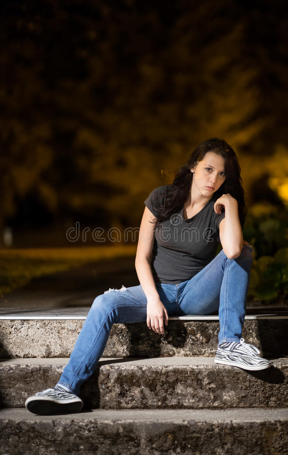 Serious girl sitting royalty free stock photos