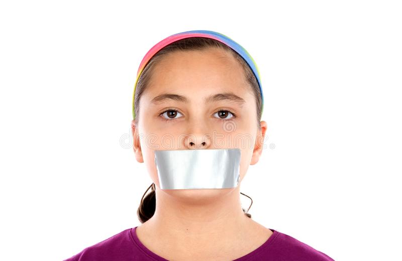 Serious girl with sticking plaster on her mouth stock photography