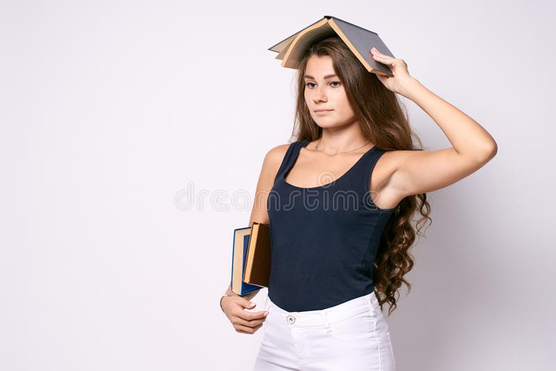 Serious girl. Young student. Stern look. Books royalty free stock images