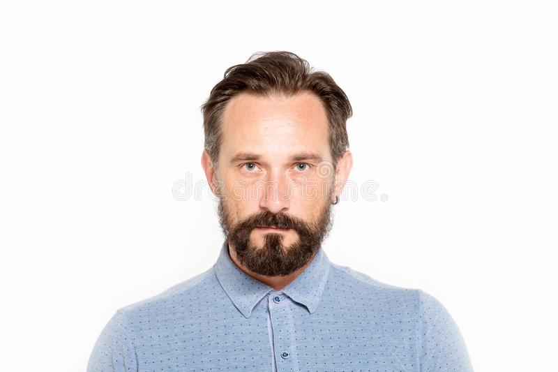 Serious glance of mature bearded man stock photo