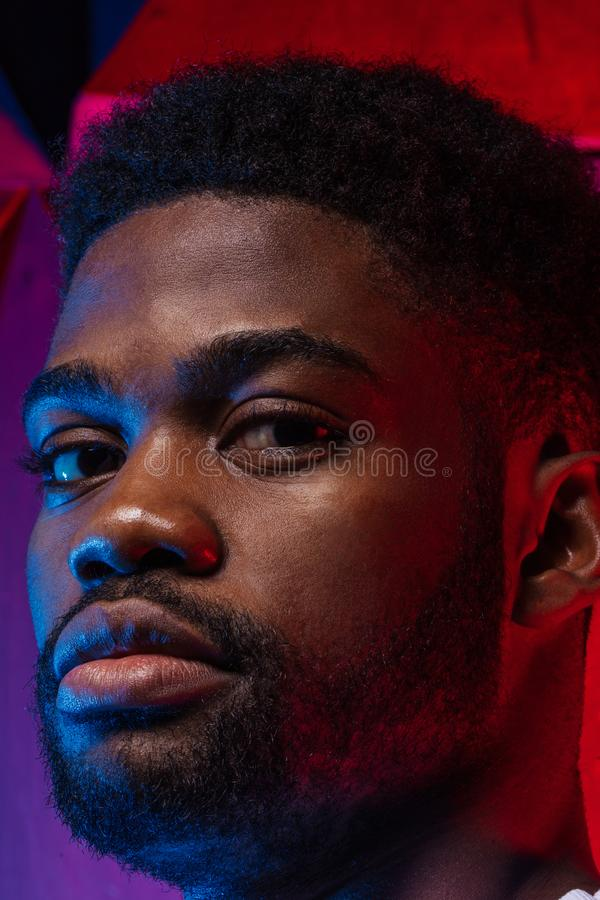 Serious gorgeous African guy looking at the camera. Close up photo, ethnicity stock photos